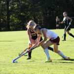 picture of students playing field hockey