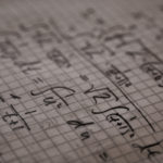 picture of math formulas on graph paper