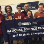 picture of science bowl team with championship banner