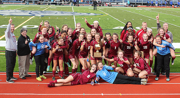 picture of girls soccer team with trophy